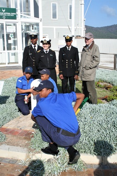 Cadets from TS Knysna tend to the grave of ship's mascot Bondi, of HMS Verbena