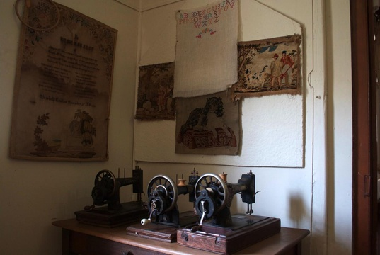 Early sewing machines with locally-made samplers in Millwood House at the Knysna Museum